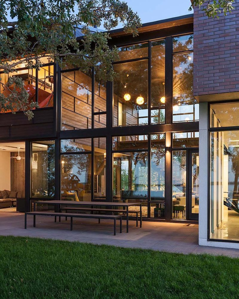 Full-height windows and large openings connect the house to its immediate surroundings and reveal great views