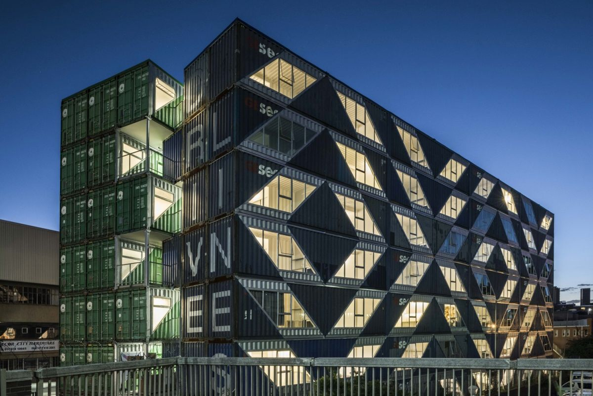 The building's name is Drivelines Studio and can be seen on the side of the blue unit section