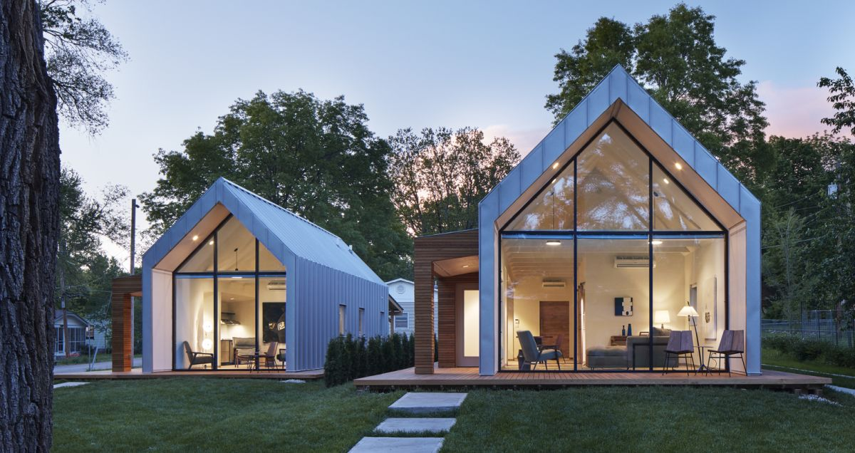 The glass facades expose the living areas to the outdoors and let the natural light in