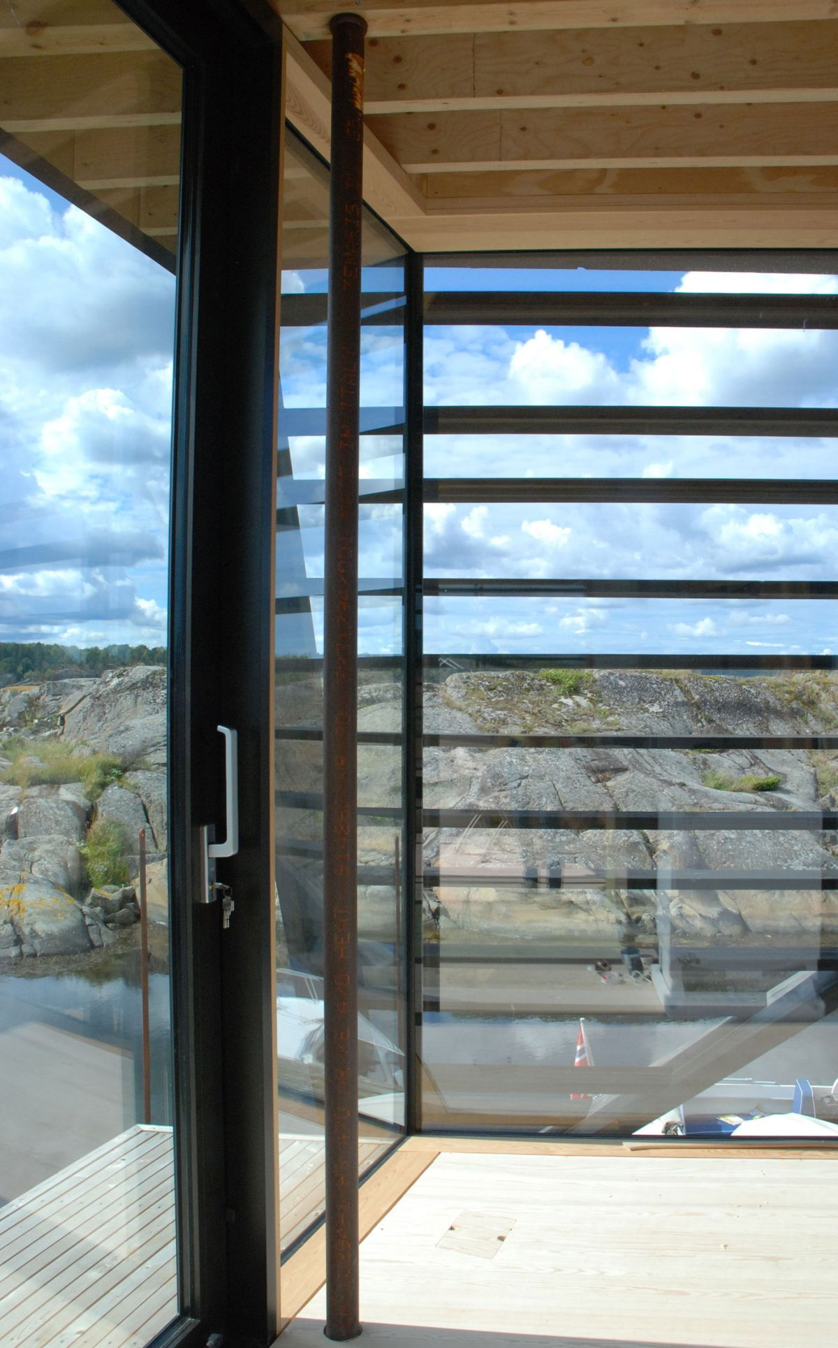Lille Arøya holiday home view through glass walls