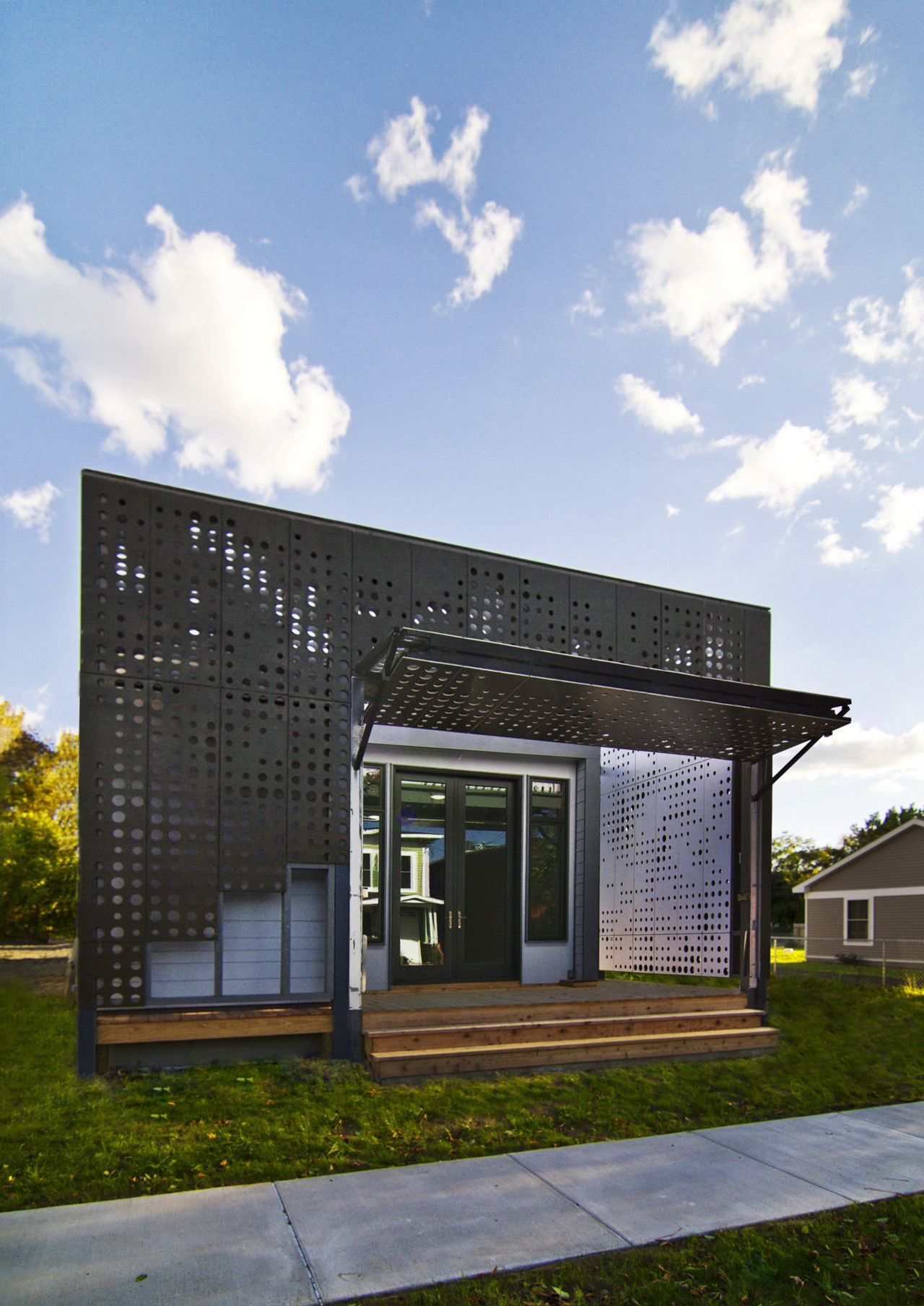 Live Work Home with a perforated Facade open