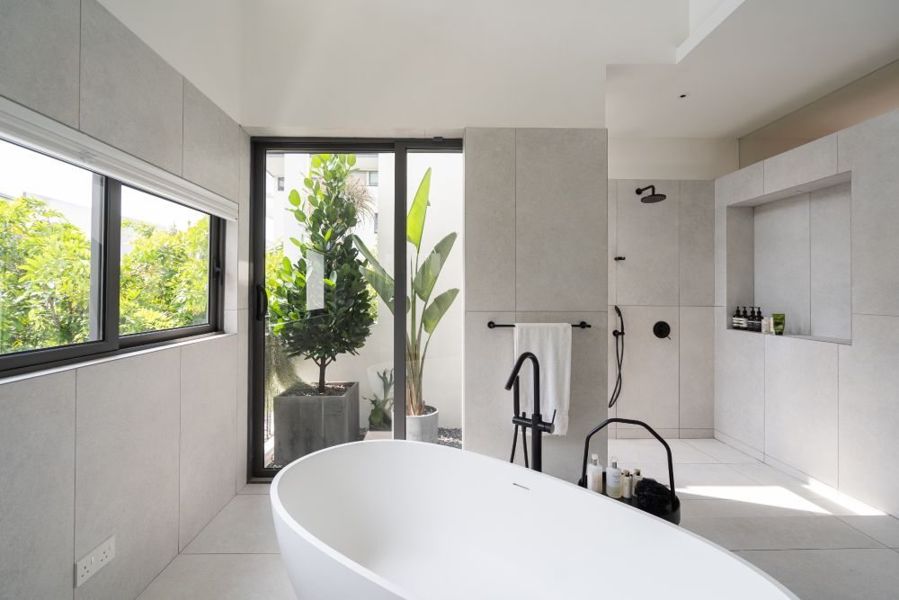 This bathroom has its own little courtyard tucked into a corner