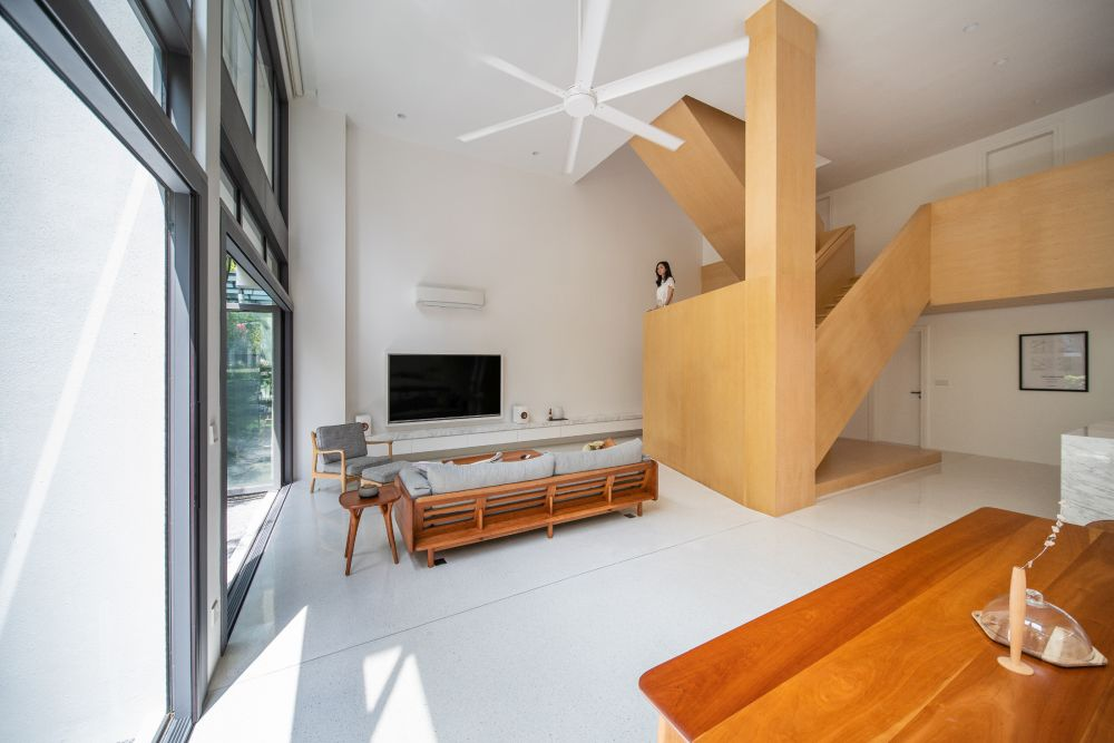 The wooden staircase was designed as a statement piece and a decorative element
