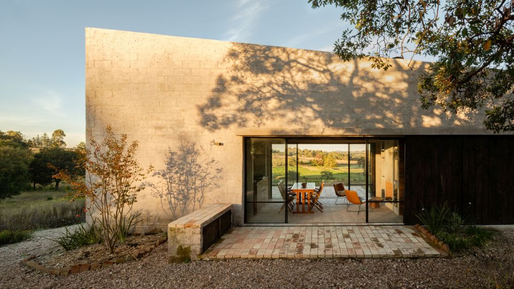 The house is slightly asymmetrical but maintain a very clean cut look and a minimalist appearance