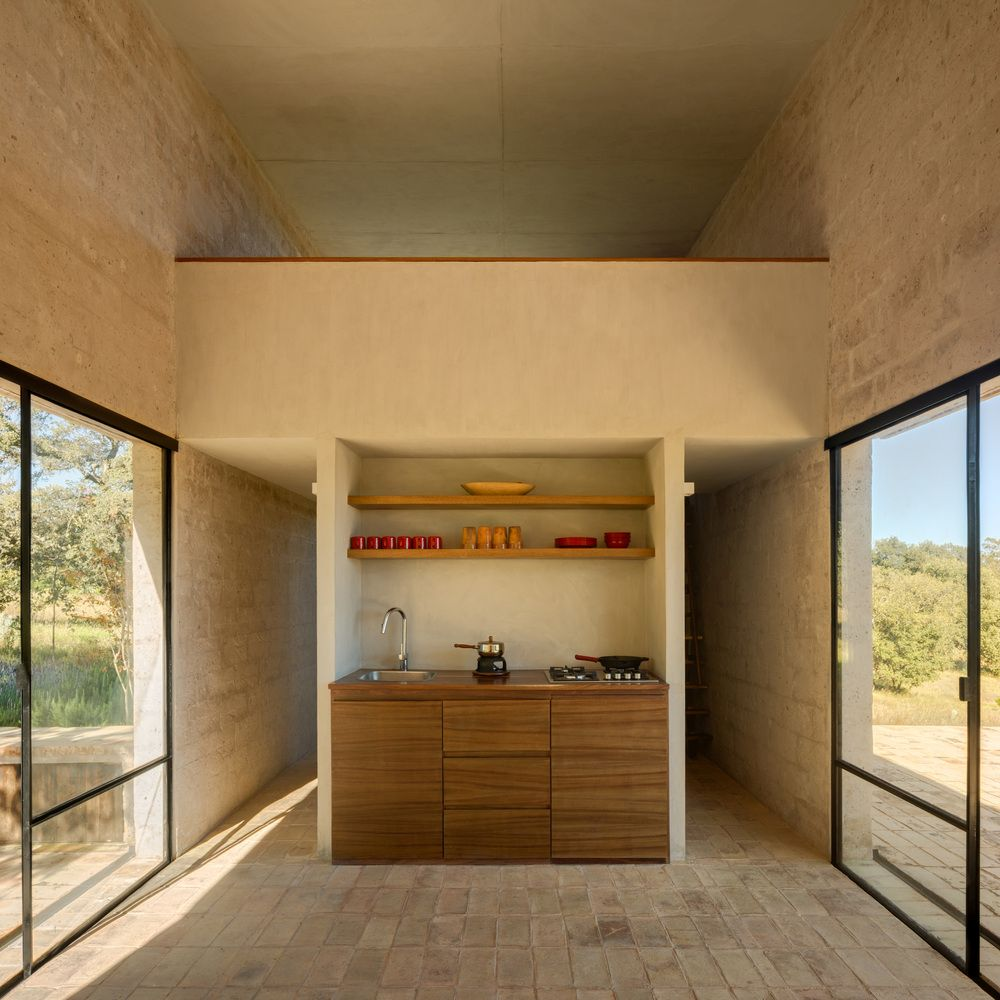 Large windows and glass doors open up the interior spaces to the beautiful views and the surroundings