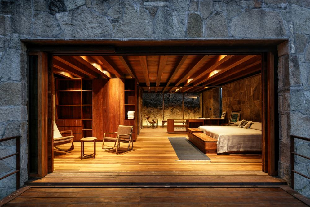 The exterior of the cabin is almost entirely covered in stone and the interior draped in wood which creates a pleasant contrast