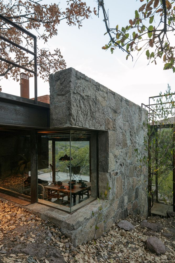 The combination of stone and glass is unusual and that's one of the details which make the cabin special