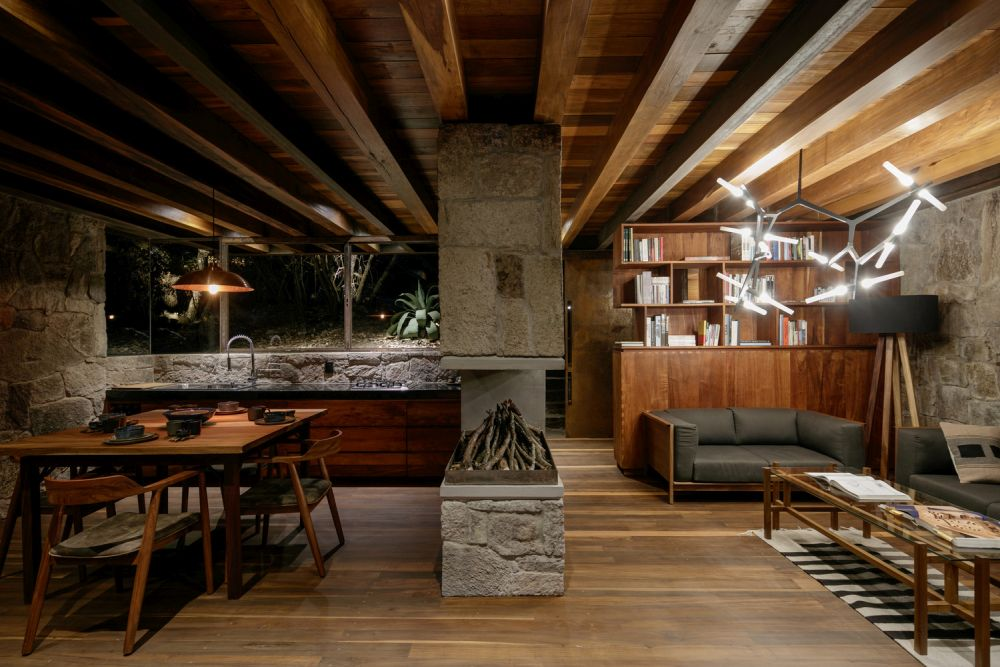 The interior is welcoming and cozy, like a mountain cabin should be, with lots of wood and stone used throughout