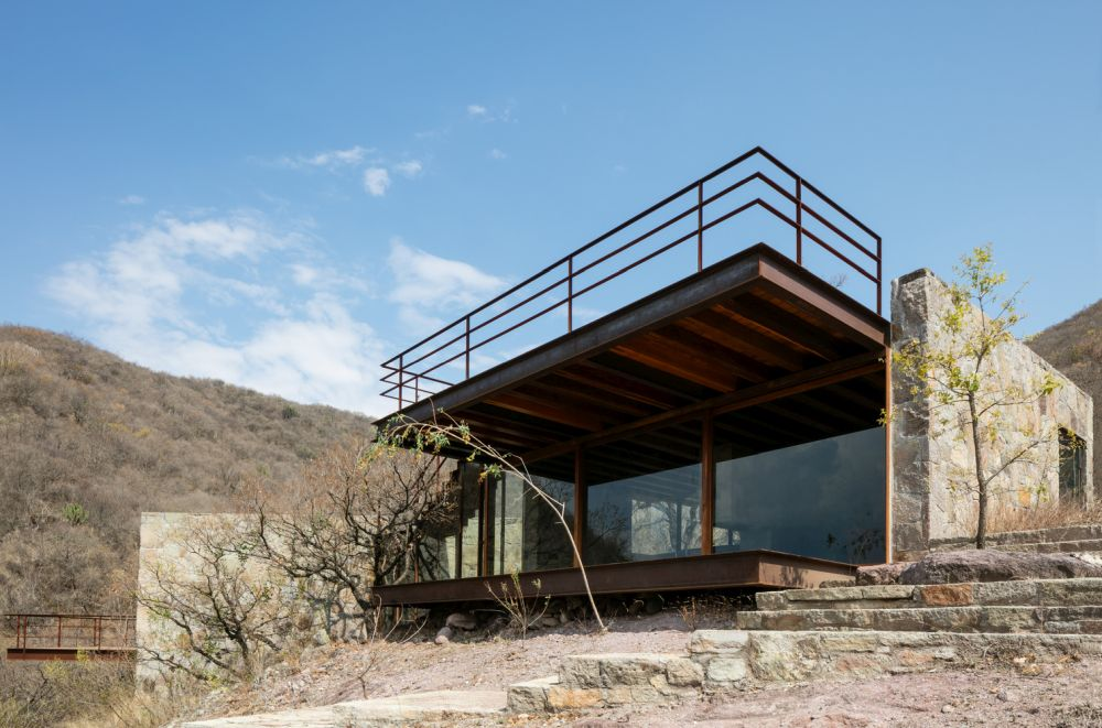 The cabin was built using local stone and wood and that helps it blend in and become a part of the landscape