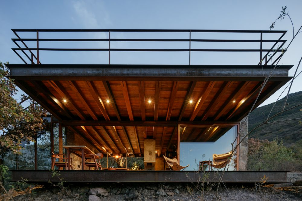 The cabin has a strong industrial vibe mixed with an overall modern appearance and a few rustic elements