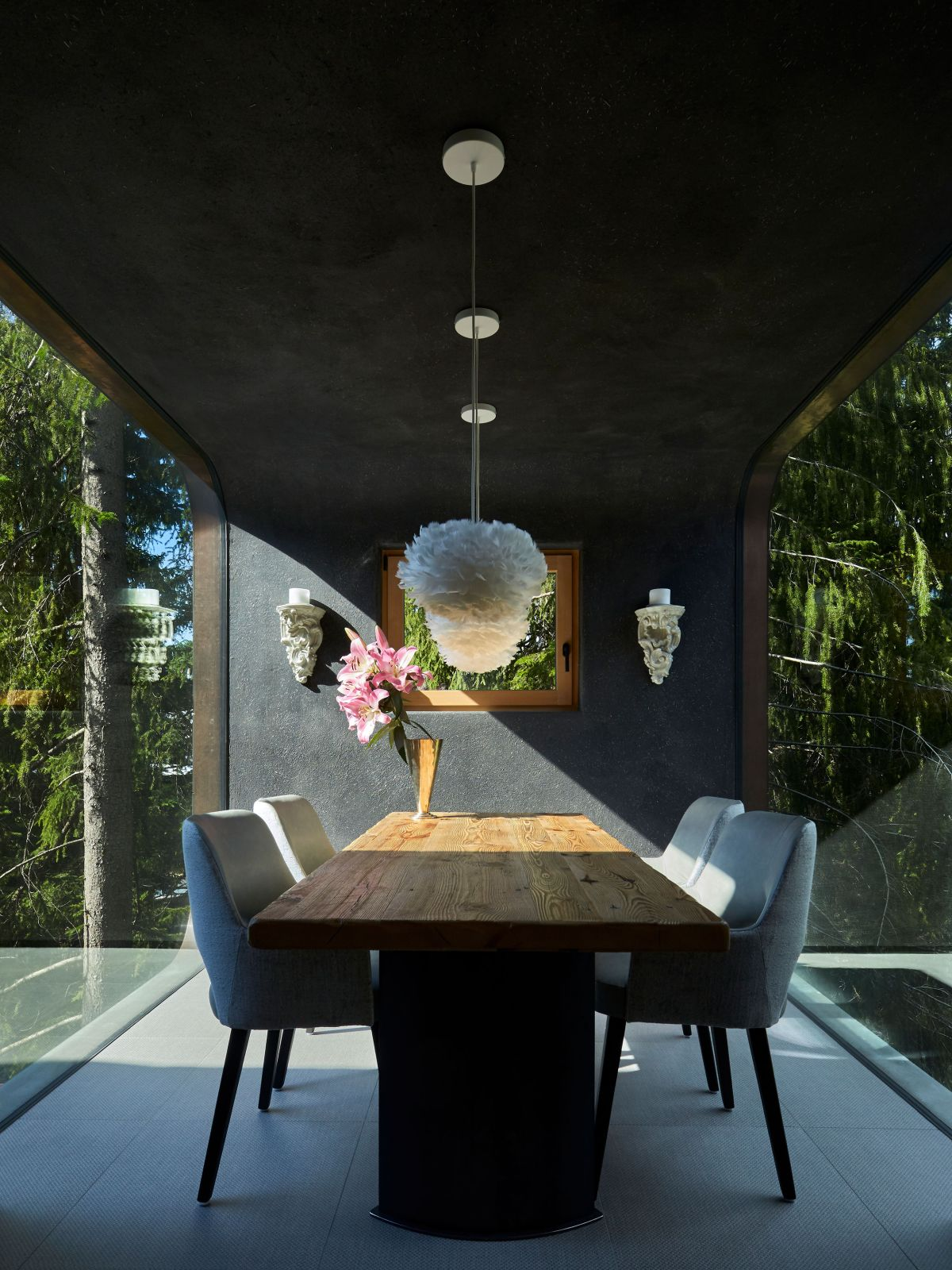The dining room is exquisite, being framed by full-height windows on two sides