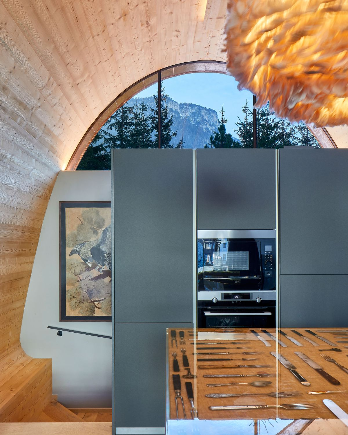 The interior is just as pleasant and cozy-looking as the exterior, featuring expansive wooden surfaces