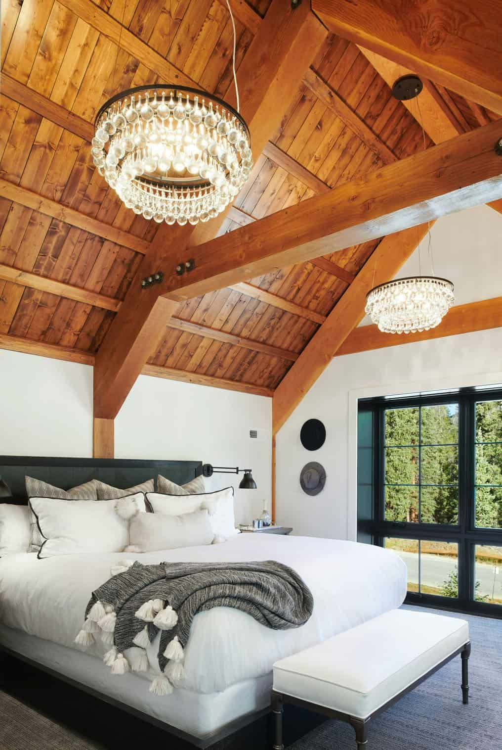 Elegant crystal chandeliers hang from the ceiling and adorn the bedrooms