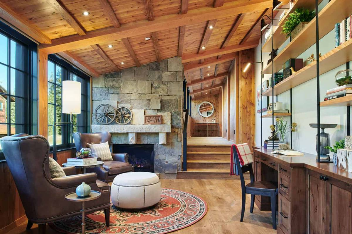 The upstairs area includes a library with a cozy seating nook and its own fireplace