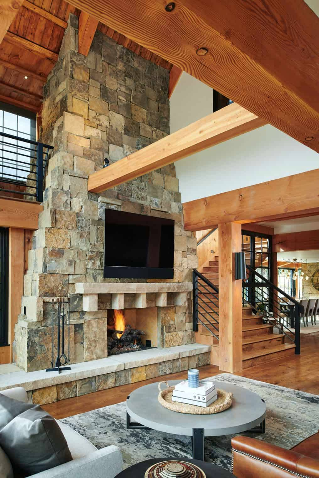 A two-story stone fireplace is the centerpiece of the living area
