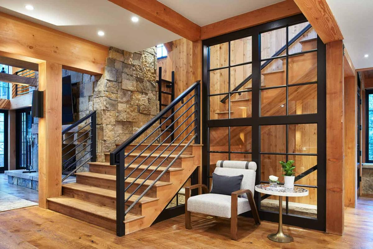 A series of wooden stairs lead to the upper section of the house where the bedrooms are situated