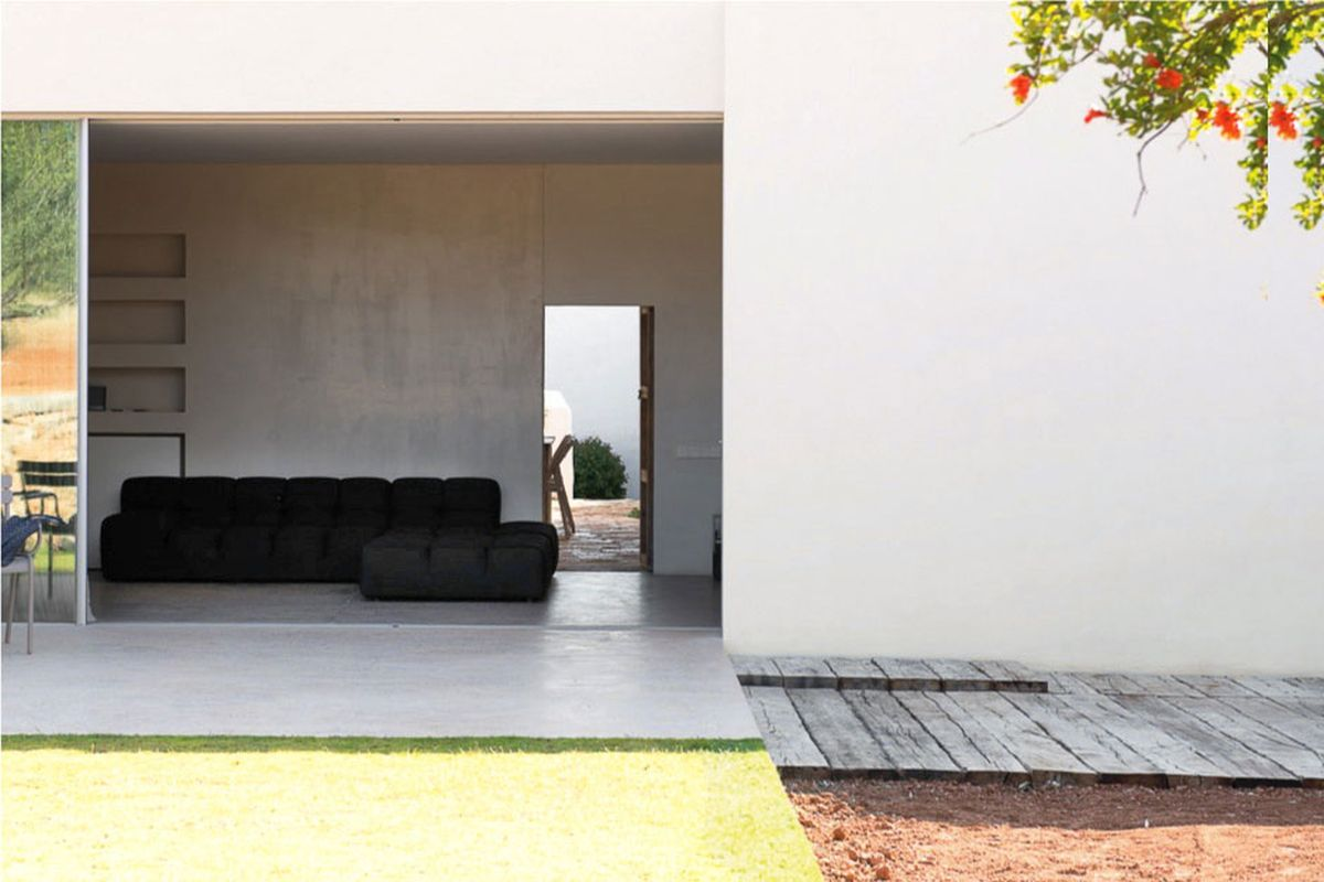 Modern Finca Can Basso transformation living room connection to terrace