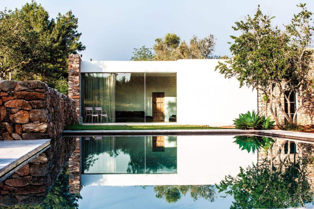Modern Finca Can Basso transformation living space view from pool