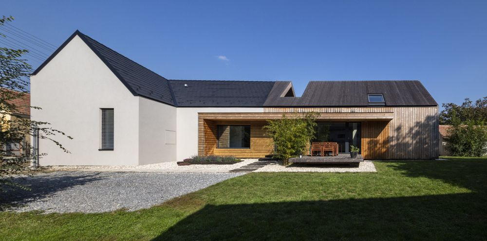 The exterior of the house and barn has changed too, now the facades looking more simple and fresh