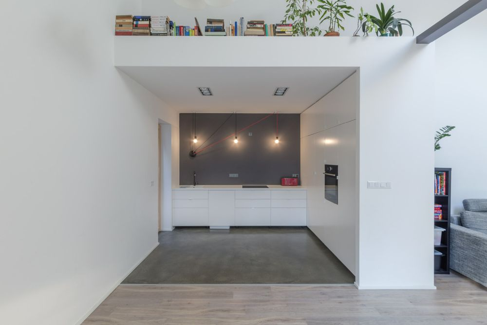 The kitchen is tucked into a nook but remains a part of the open floor plan