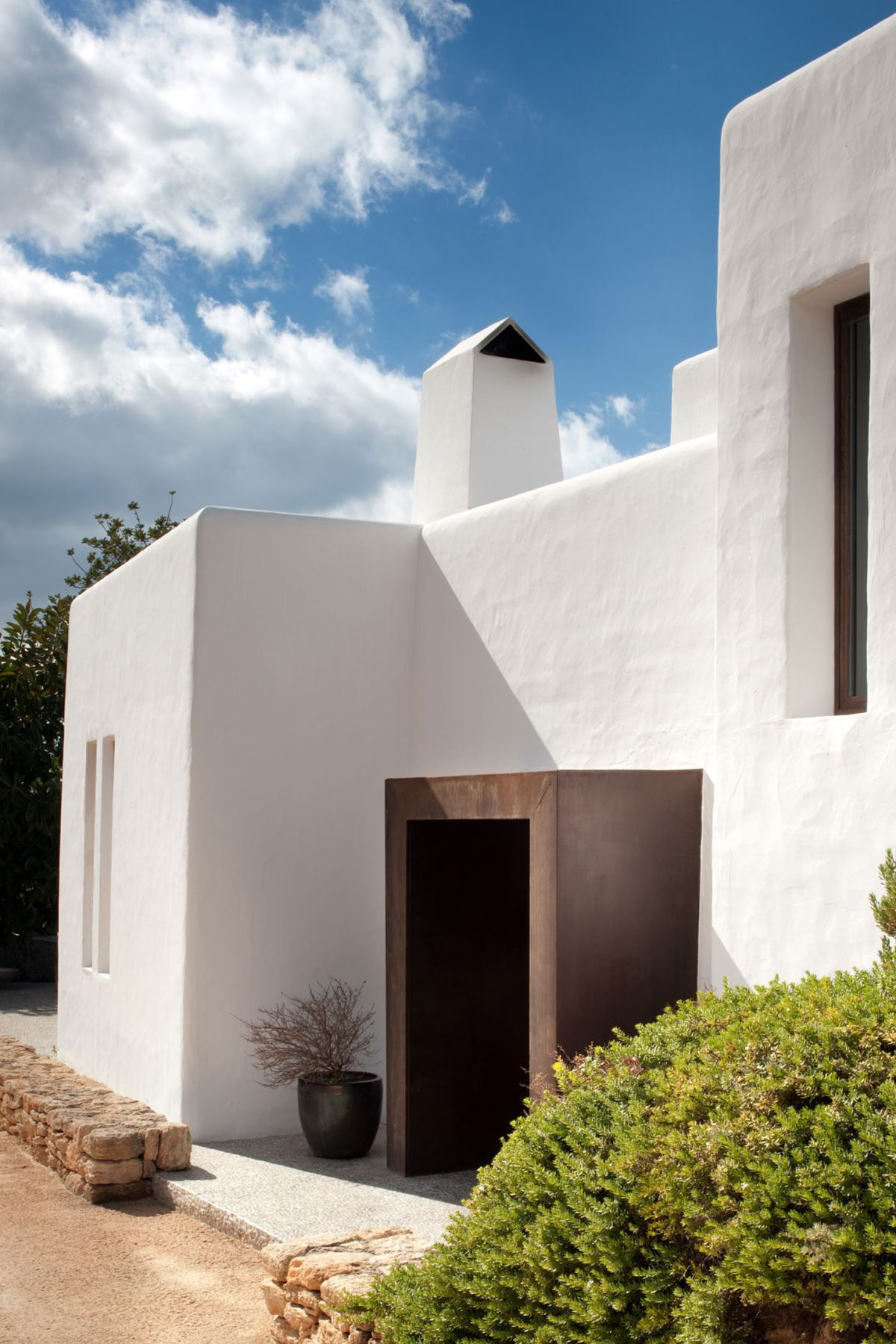 Modern Ibiza home by TG Studio - front entrance