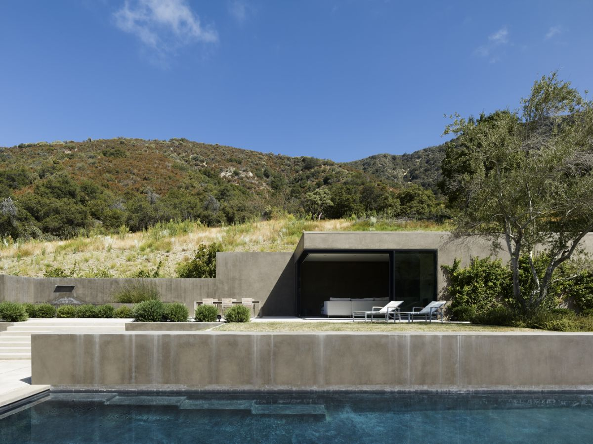 The pool house is very interesting because it's built into the hillside and thus blend into the landscape very easily