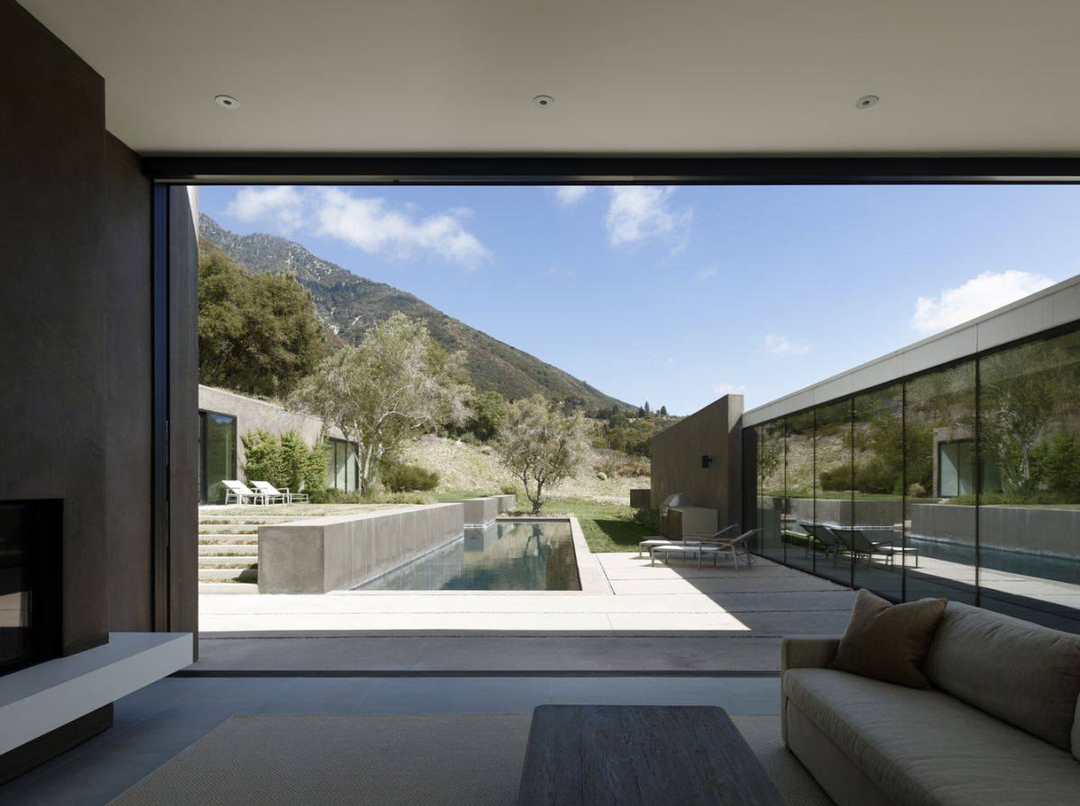 The lap pool and spa are the main features which fill in the spatial gaps between the main residence and the pool house