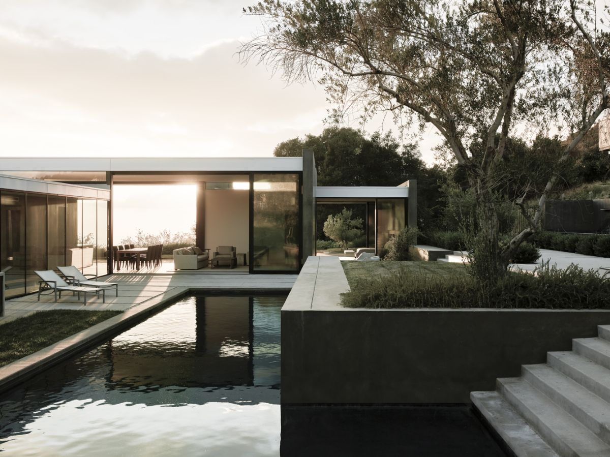 The main house is positioned slightly lower than the pool house which gives it a unique view of the surrounding landscape