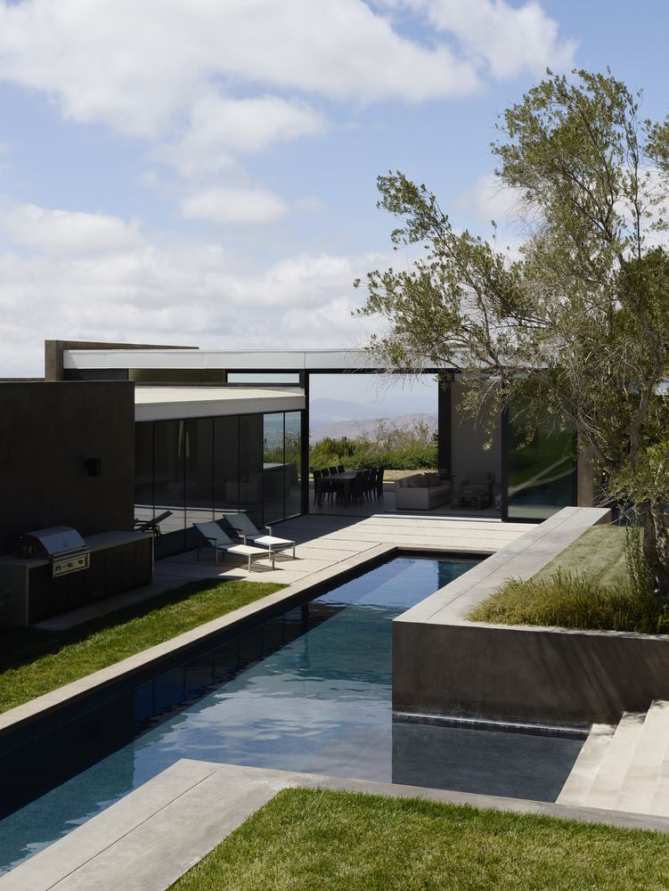 The main residence and the pool house function as separate structures but still remain connected on a higher level