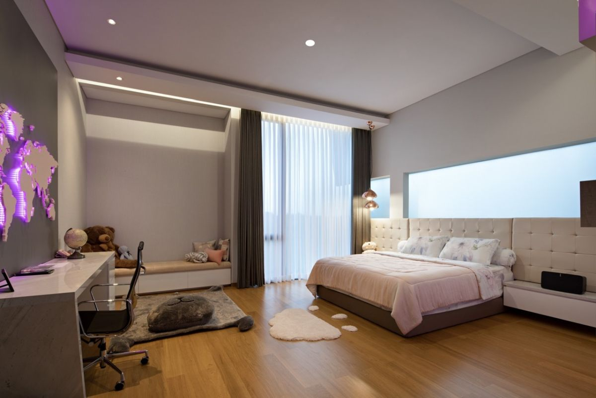 Another bedroom has a very cozy nook and is decorated with warm greys and pastel pinks