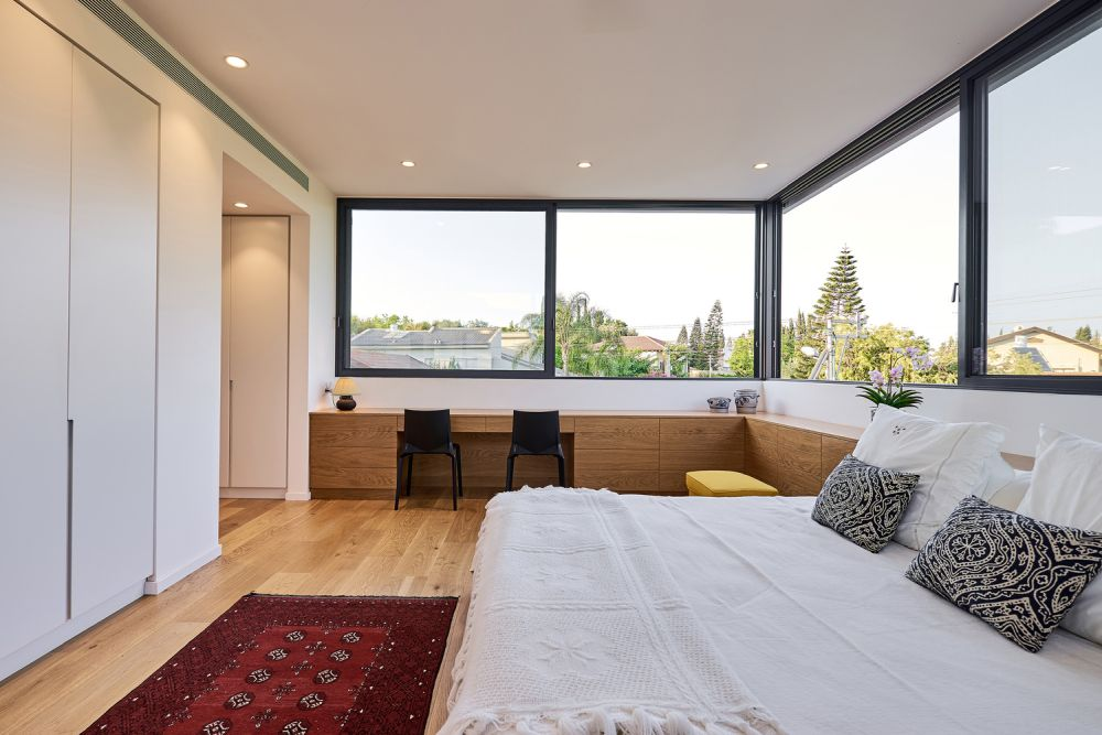The upper floor is divided into two wings, one of which contains the master bedroom suite