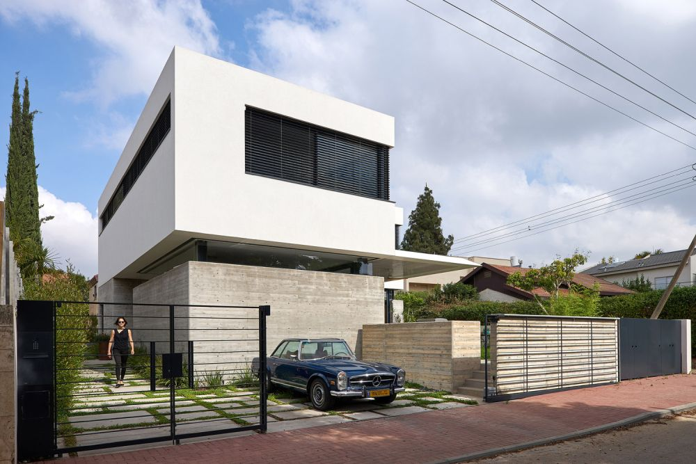 The solid concrete walls which frame the ground floor are meant to offer privacy without closing off the spaces completely