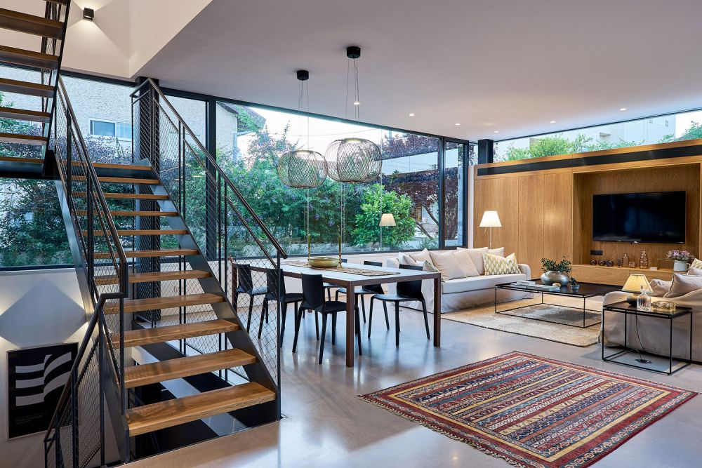 The ground floor is a single large and open space, with the exception of the home office which sits separately in a corner
