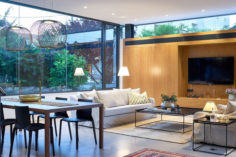 The street-facing walls on the ground floor have clerestory windows that let in light and views towards the sky