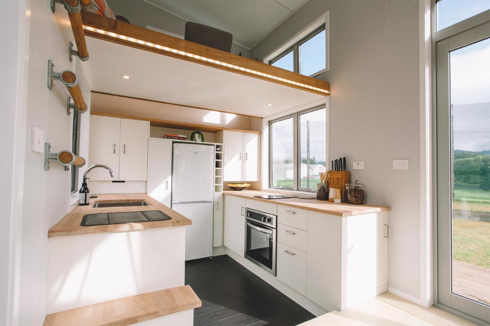 The loft office is placed above the kitchen and gets sunlight through a small window