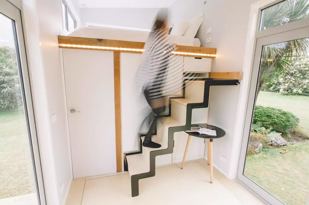 To access the sleeping area one goes up a staircase which was designed to be retractable