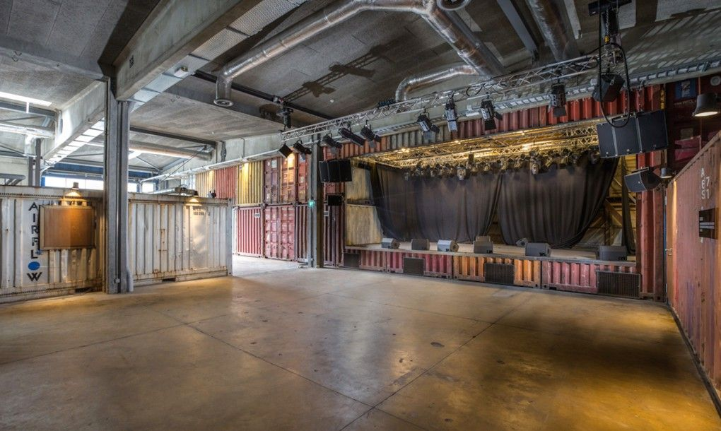 Old shipping containers into an edgy concert hall