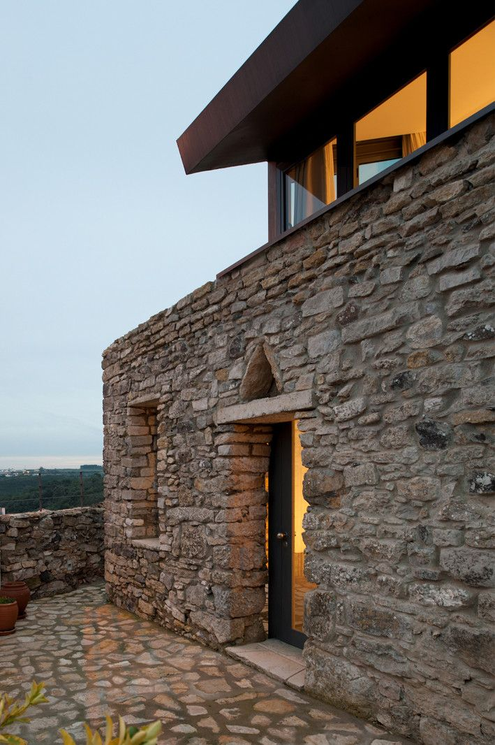 Old struture Cabrela House by Orgânica Arquitectura