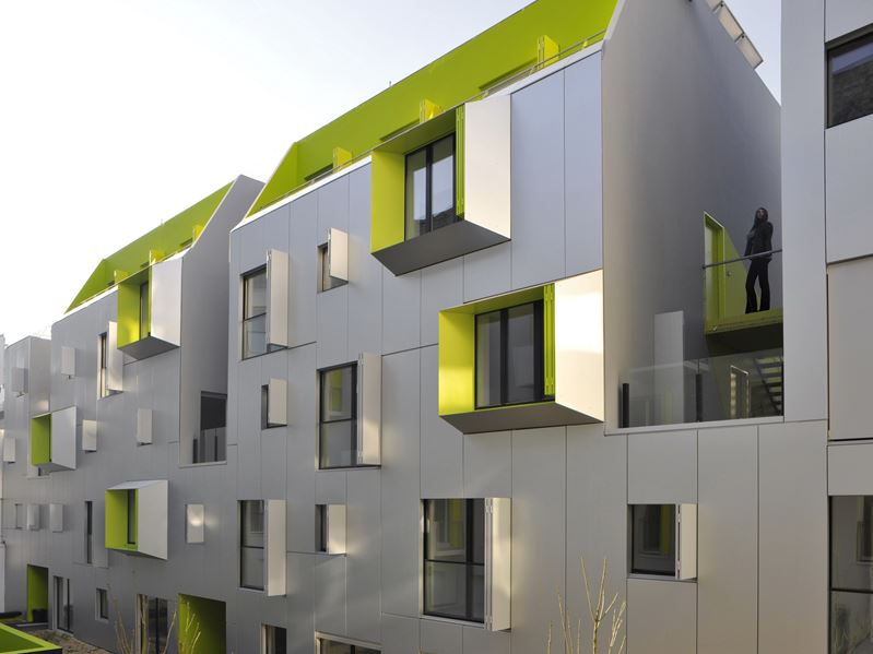 Paris building facade in silver with green accents