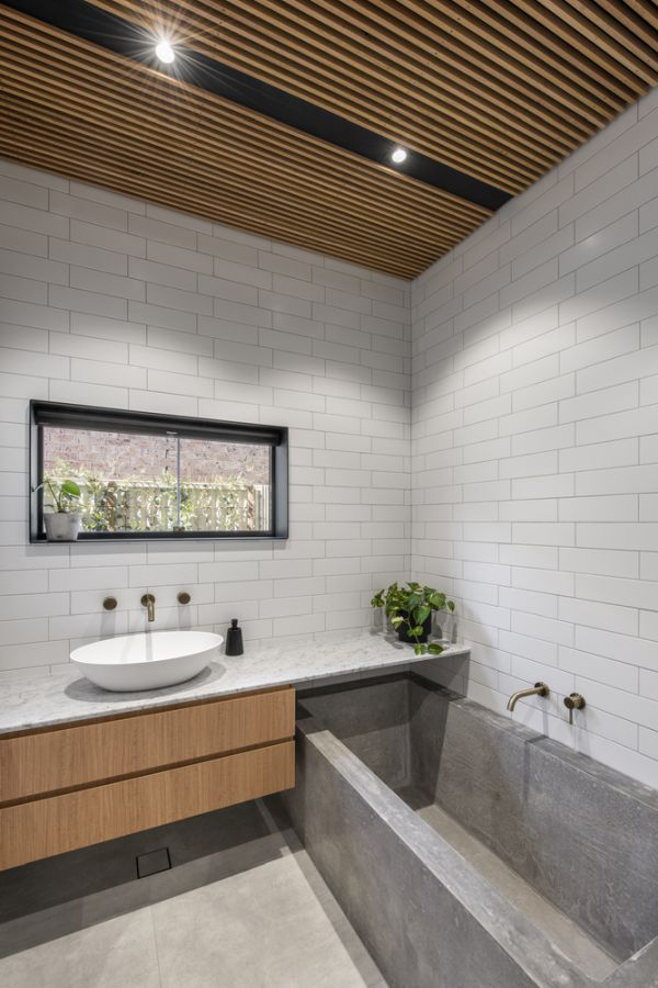 The concrete bathtub is an unexpected but also really cool feature