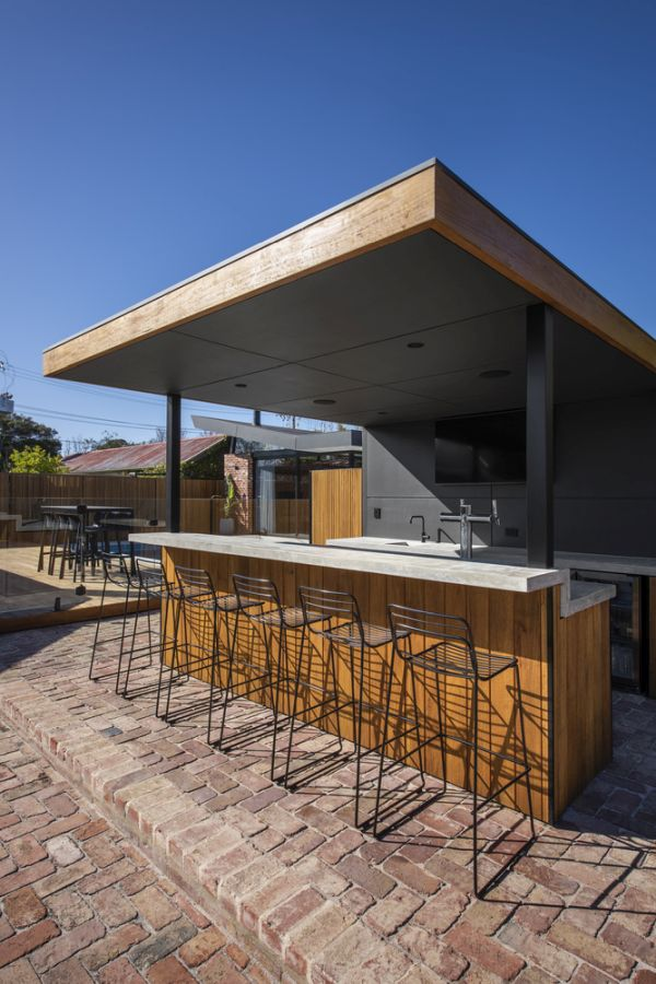 This beautiful outdoor bar area is placed along the side of the house