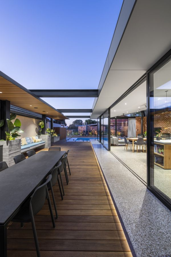 A subtle band of LED lights marks the transition between the concrete floor and the wooden deck