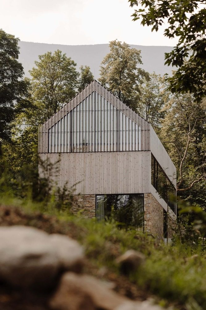 The buildings have a modern cabin-like design and blend in nicely with the landscape