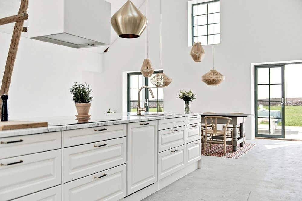 The lack of color is balanced by the presence of numerous different textures and finishes throughout the interior design