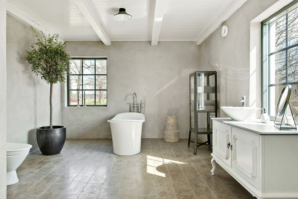 The bathroom is surprisingly one of the most colorful areas of the house, featuring a soft gray tone on the walls