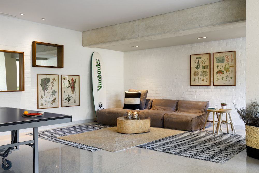 On the inside, the house is warm and welcoming but also sophisticated and simple, a balance achieved through eclecticism