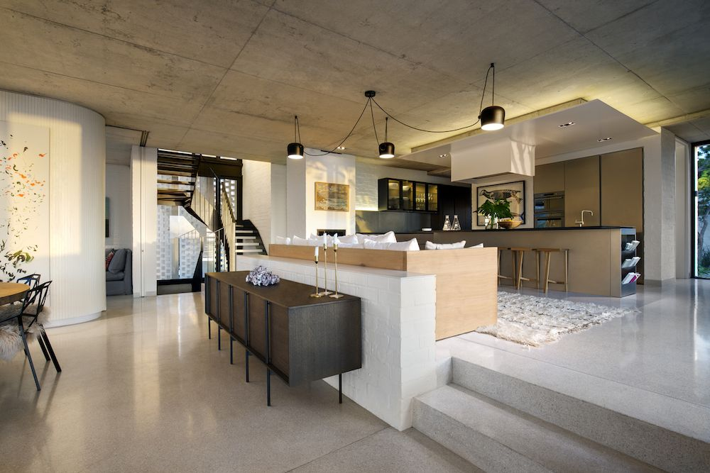 The ceiling was left bare, showcasing the raw concrete and contributing to the overall eclectic feel of the house