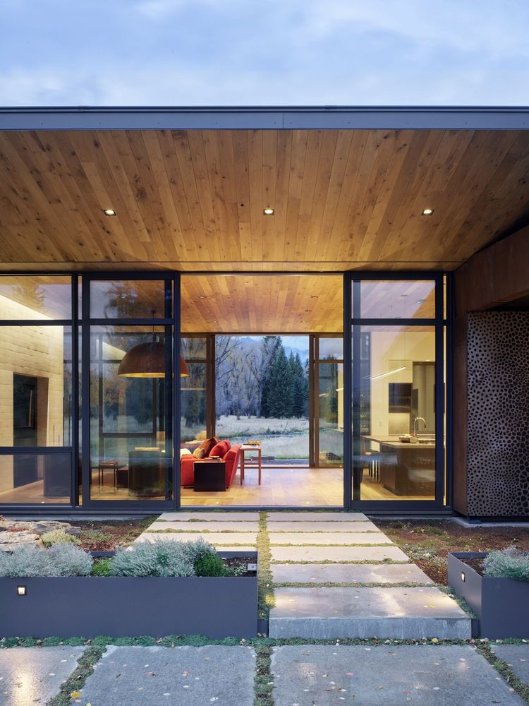 The deep overhangs offer protection but also ensure a seamless connection between the indoor and outdoor spaces