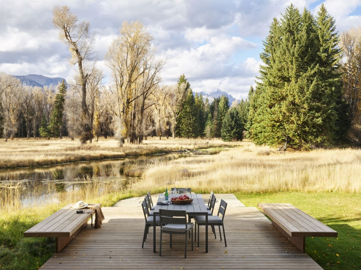 This modern wooden deck is one of the best spots on the property, perfect for admiring the scenery