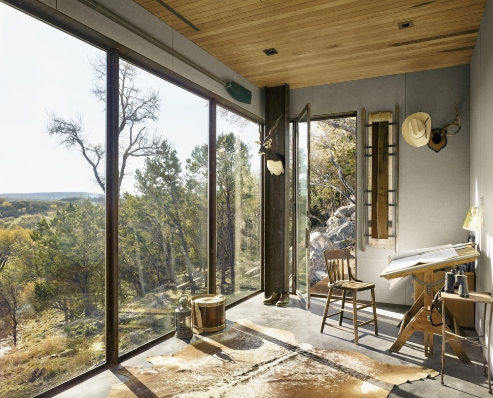 The big glass windows bring the gorgeous landscape inside the cabin
